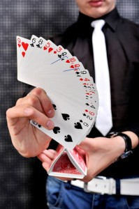 magician_shows_stunts_and_tricks_with_cards_sleight_of_hand_glamour_background